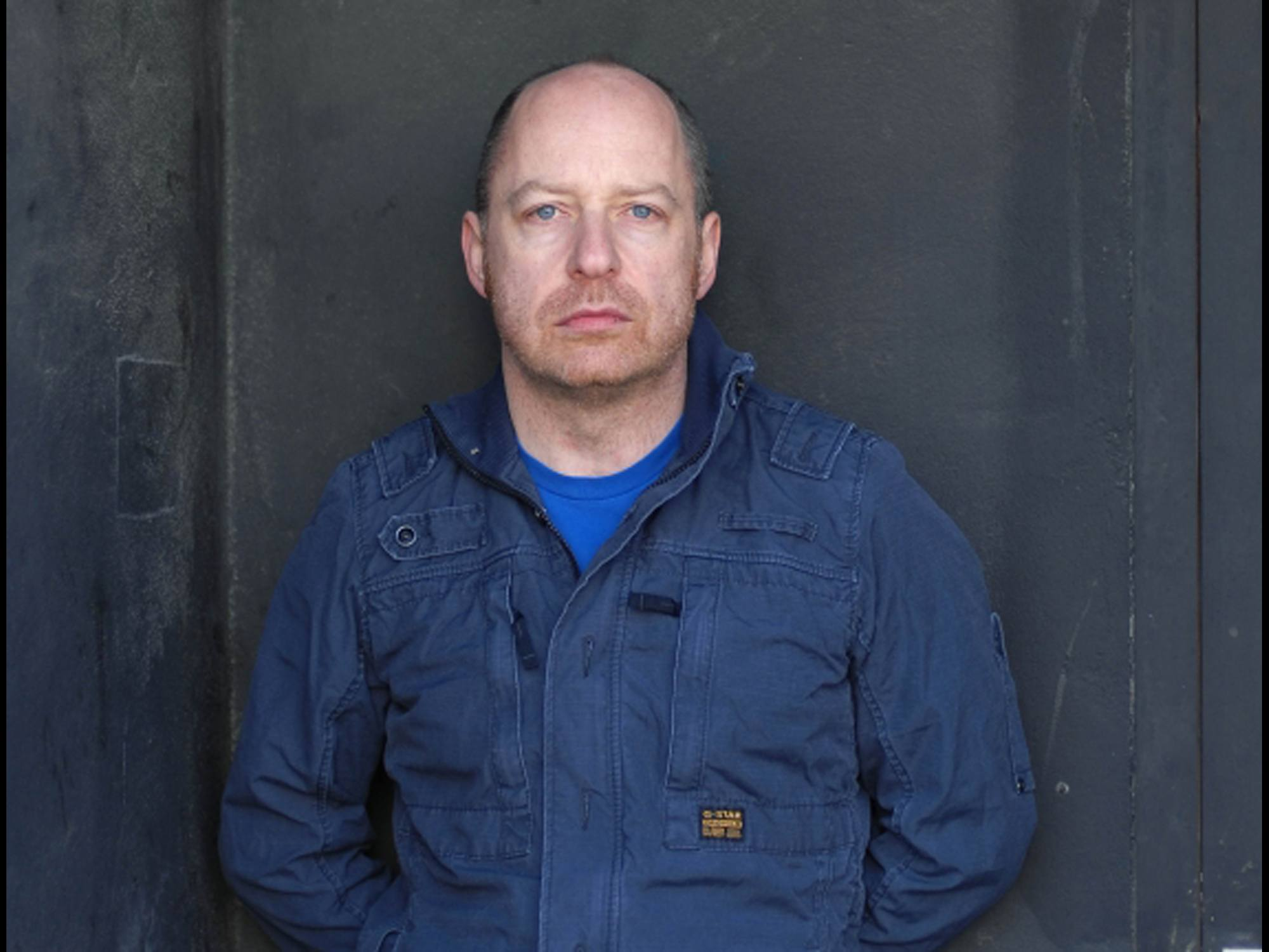 An image of Tim Etchells. He is a white man wearing a blue jacket.