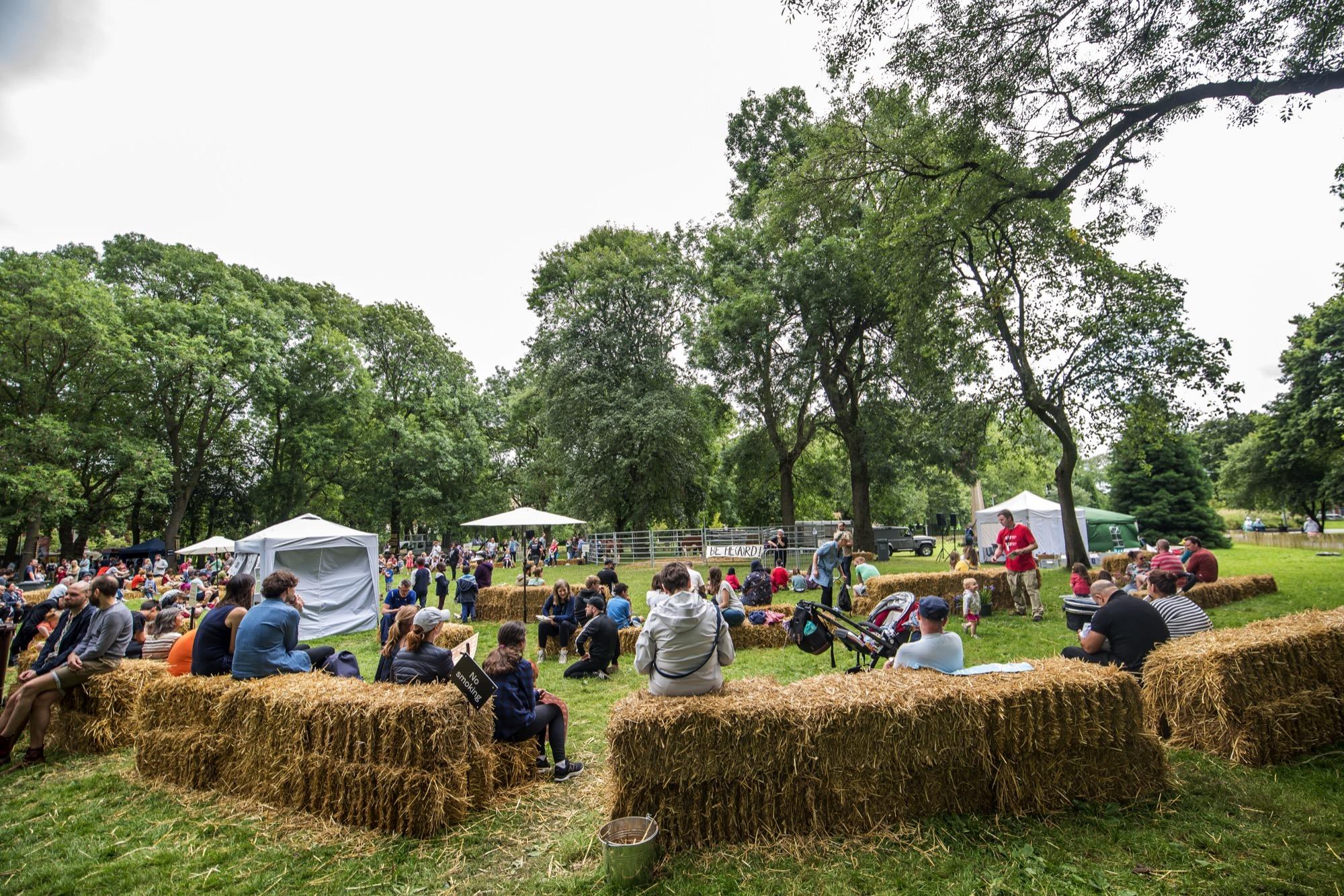 people sitting on hay bales