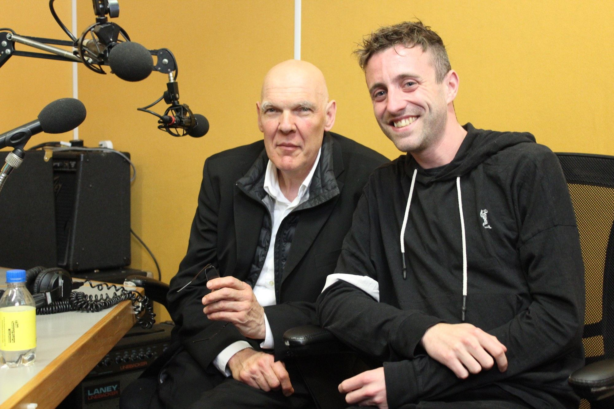 Nigel Rolfe and Martin O'Brien sit side by side in a radio recording studio