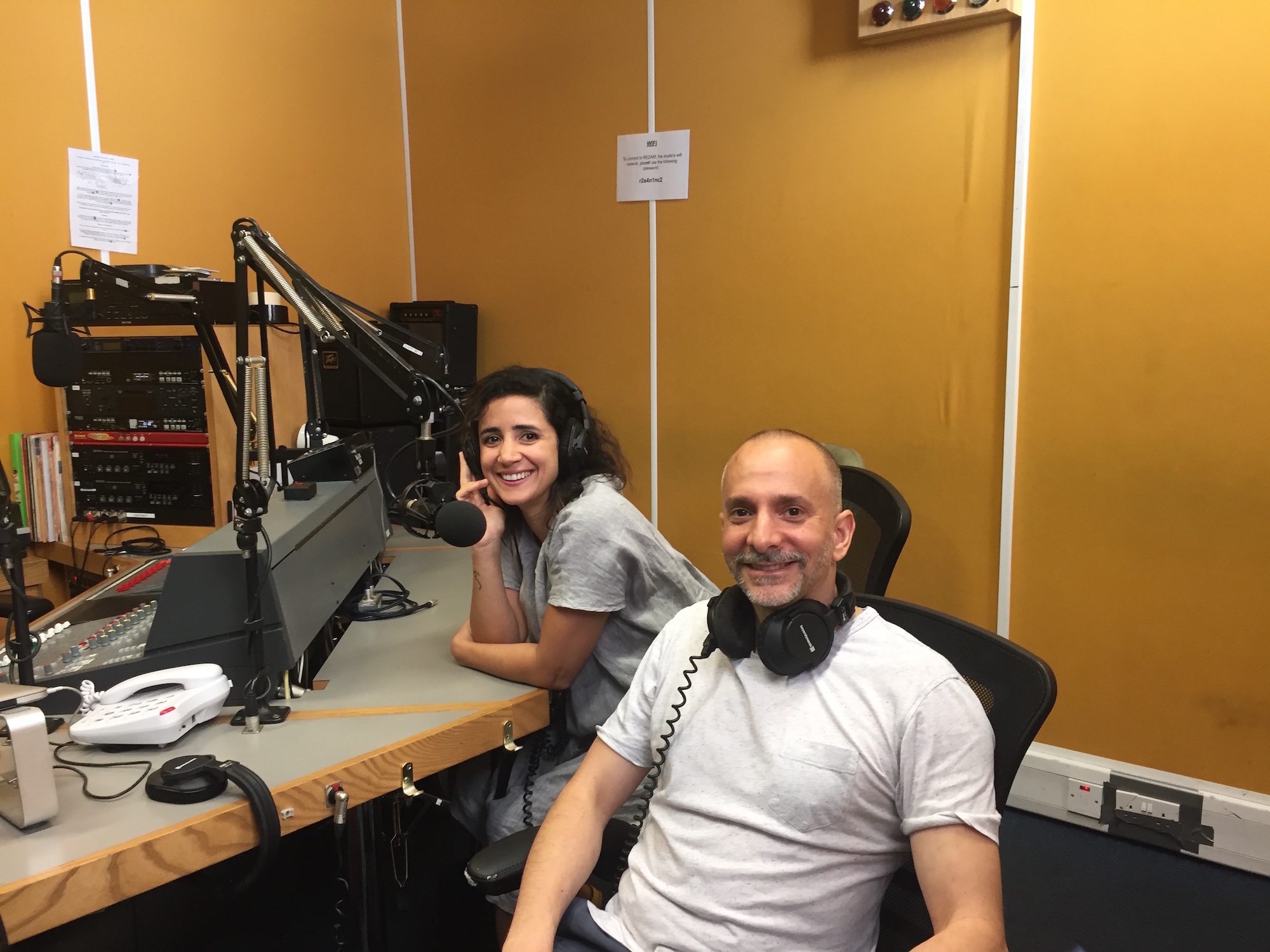 Joshua Sofaer and Tania El Khoury sit side by side in a radio recording studio